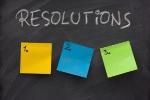 list of resolutions on blackboard with three blank, numbered sticky notes