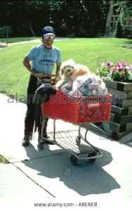 homeless-man-age-45-pushing-cart-of-aluminum-cans-with-dog-minneapolis-A8EAEB