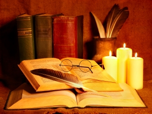 bigstock-stack-old-book-and-candle-edu-22209629